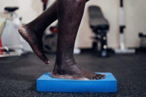 Balancing one leg on foam pad
