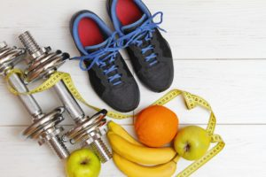 Picture of shoes, weights and fruit