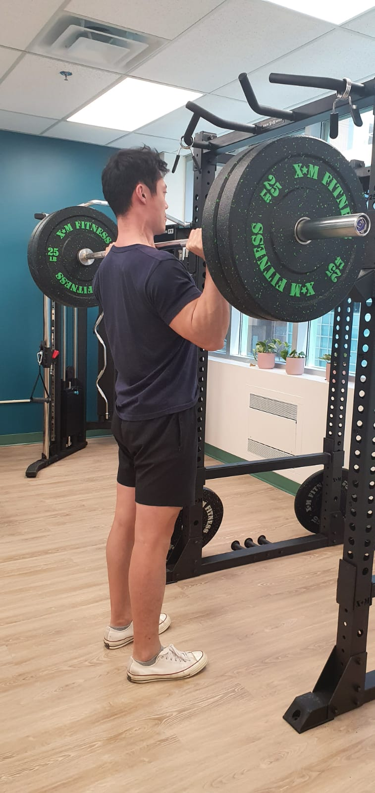 Person performing overhead shoulder press