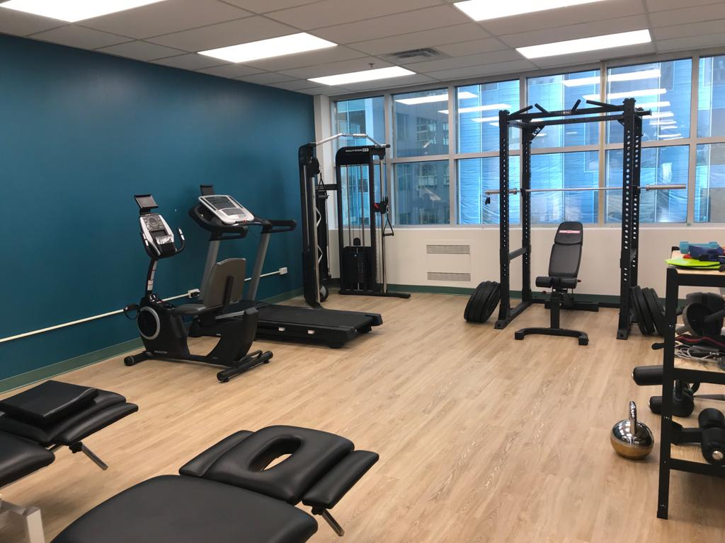 Treadmill and recumbent bike in large gym area